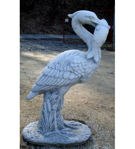 Pták s rybou v zobáku